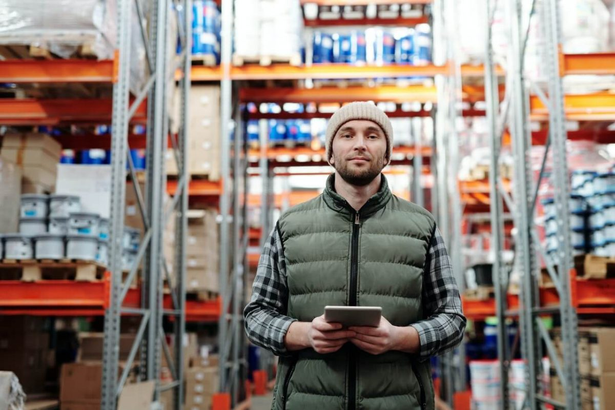 employee using enterprise software in warehouse